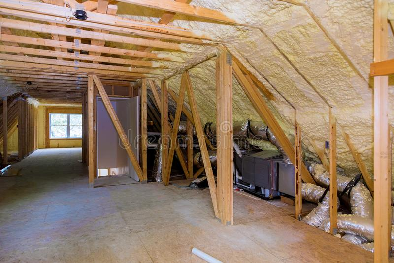 Foam plastic insulation installed in the sloping attic of new frame house. Foam plastic insulation installed in the sloping attic of a new frame house stock photo