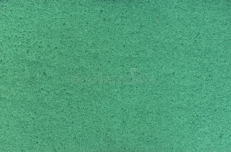 Foam rubber. Surface of a piece of green foam rubber stock images