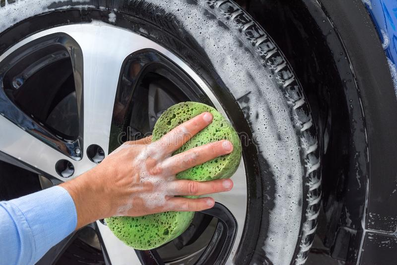 A Hand Washing A Black Car Stock Photo Image Of Dirt