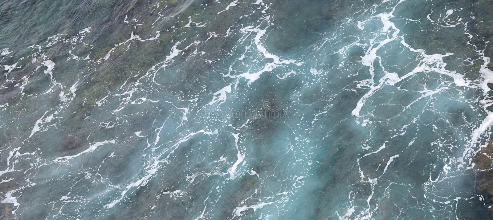 Foam and Waves of Greenish Blue Ocean Water - Abstract Natural Aqua Background and Texture royalty free stock photo