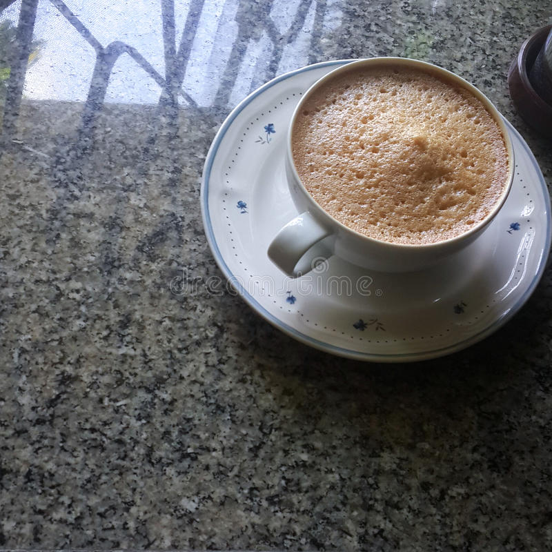 Foamy Coffee on stone floor royalty free stock images