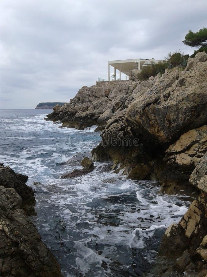 Foamy Croatian rocky coast in the morning royalty free stock photos