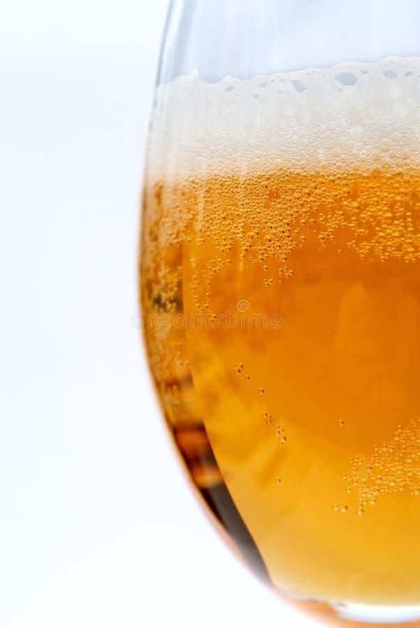 foamy exponeringsglas för öl arkivfoton