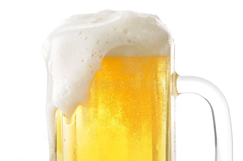 Foamy mug of beer closeup. Closeup of a foamy mug of beer stock photos