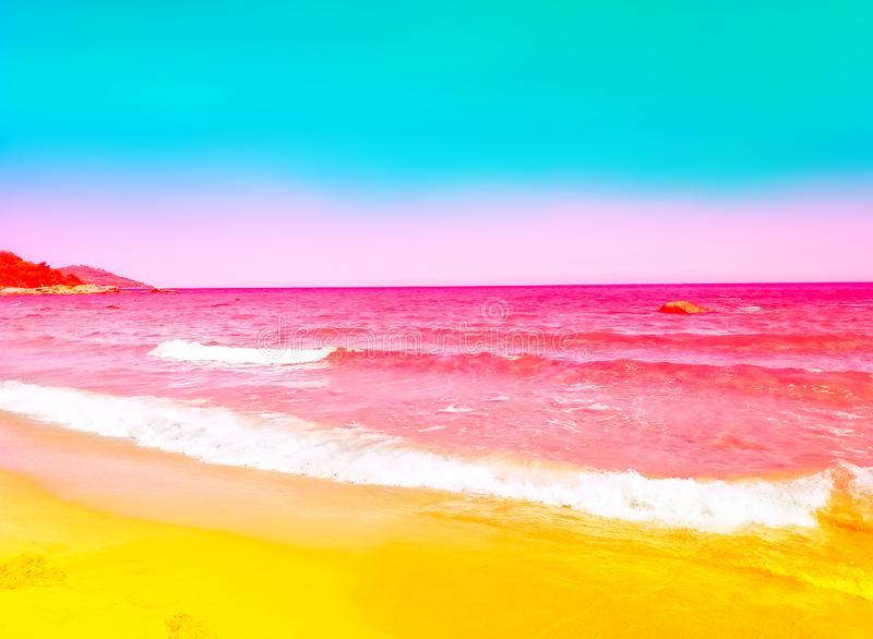 Foamy rippled pink sea wave rolling to yellow sand shore. Turquoise blue sky. Beautiful toned image with bright neon colors stock photos