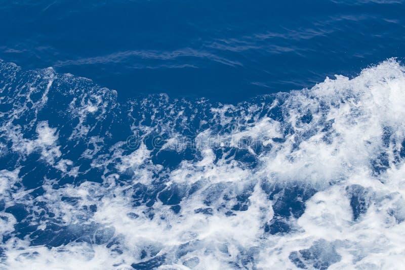 Foamy sea water. Foamy blue sea water as background stock photography