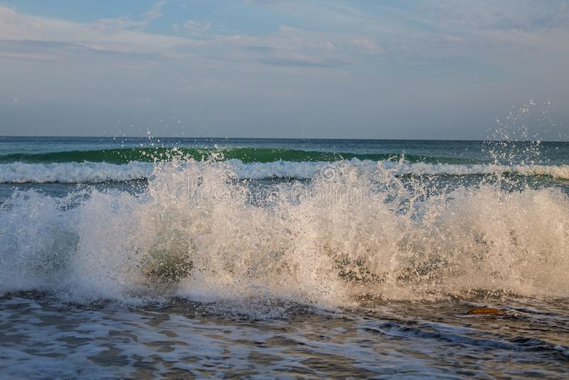 Foamy sea wave stock photo
