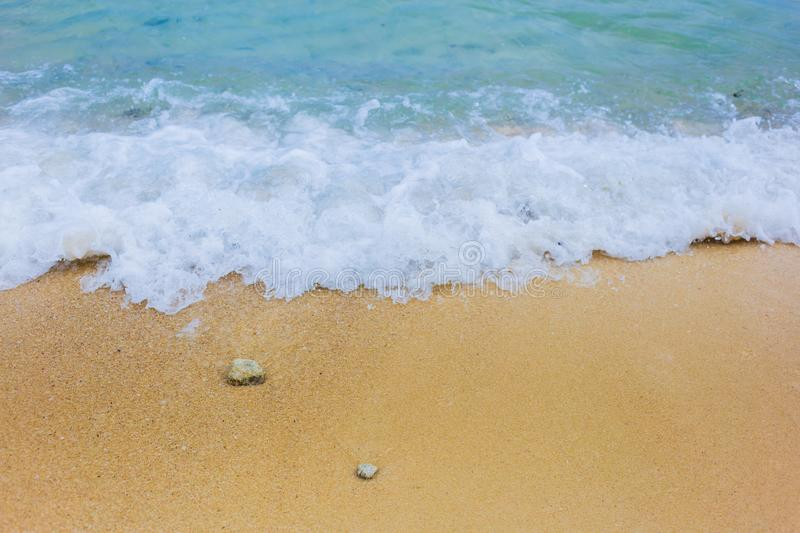 Soft waves with blue sea on golden sand stock image