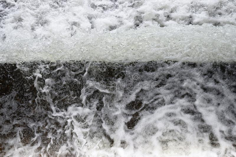 Foamy Surface of Running Water with an Unusual View - Abstract Natural Background royalty free stock image