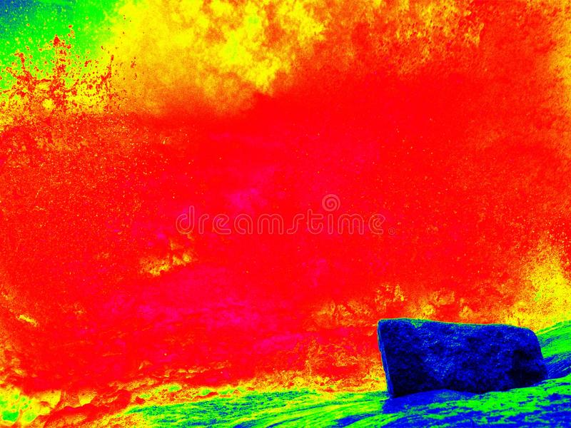 Foamy water of waterfall, looks like hot magma. Cold water of mountain river in infrared photo. Amazing thermography. Foamy water of waterfall, looks like hot stock photo
