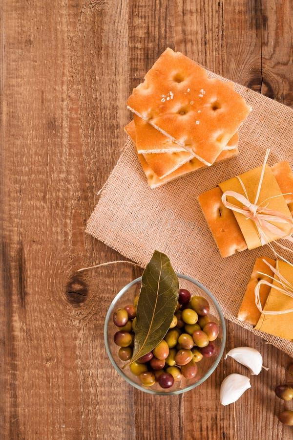 Focaccia bread on cutting board. Focaccia bread on wooden table stock photos