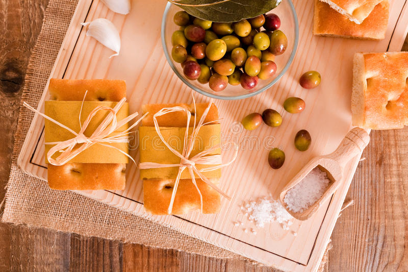 Focaccia bread. Focaccia bread with olives on cutting board stock photography