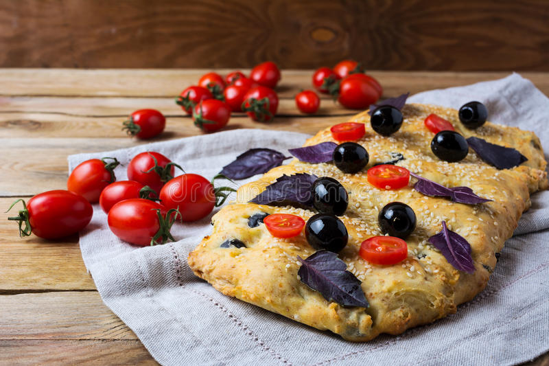 Download Focaccia With Olive, Cherry Tomato And Basil Leaves Stock Photo - Image of bread, flour: 85149024