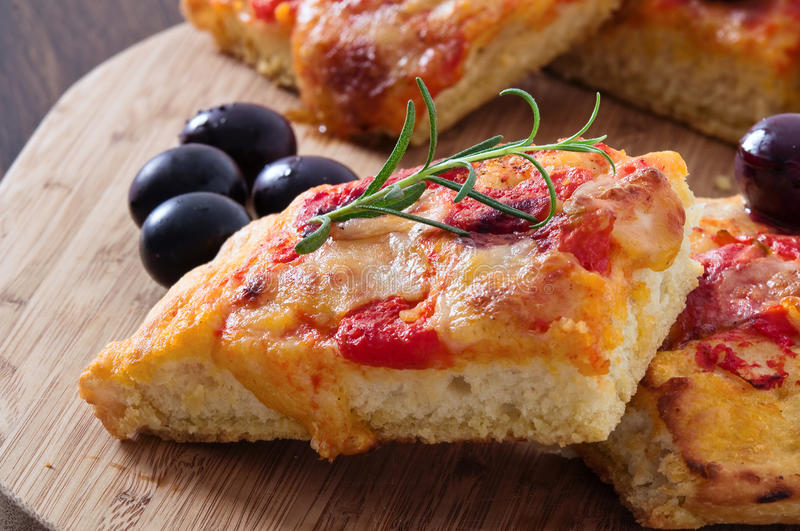 Focaccia with tomato and black olives. royalty free stock photos
