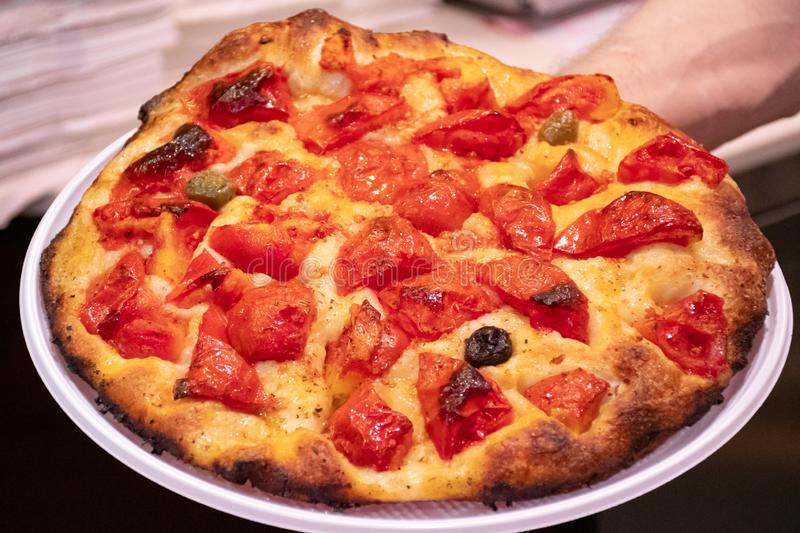 Focaccia, typical traditional food of Bari, Puglia, Italy, baked tasty hot bread. With tomatoes, olives and olive oil stock photos