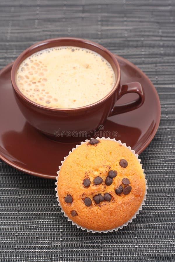 Focaccina e tazza di caffè immagine stock libera da diritti