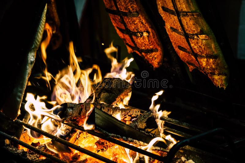 Focal Point Photo of Burning Wood in Black Steel Grate stock photo