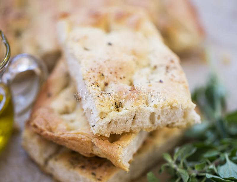 Foccacia bread closeup with olive oil and oregano herb, selective focus of freshly baked italian bread stock image