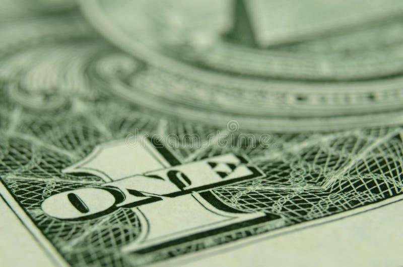 Foco bajo en UNO del billete de dólar americano foto de archivo libre de regalías
