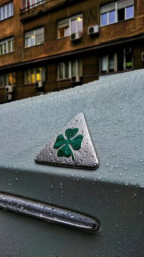 A close up of the Quadrifoglio logo. Focues shot of the green clover on Alfa Romeo royalty free stock photos