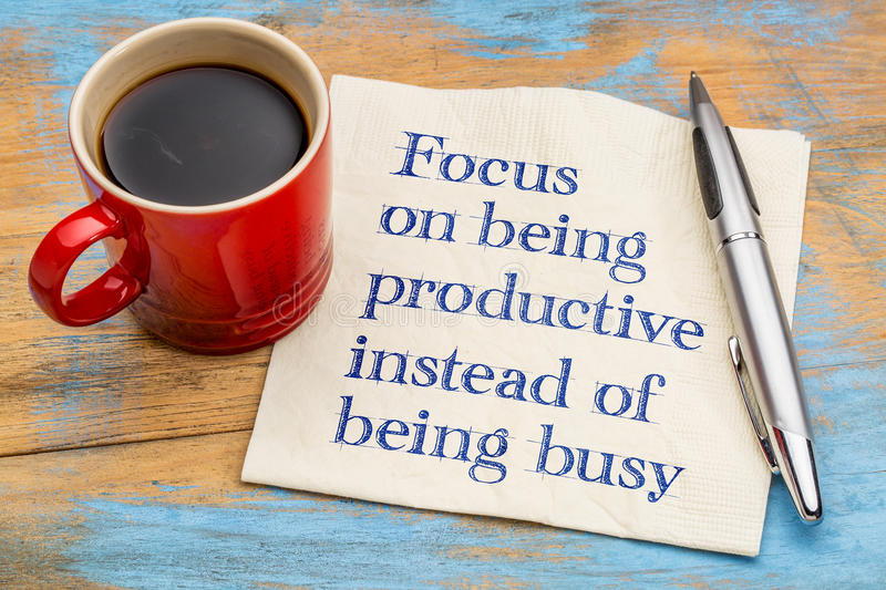 Focus on being productive instead busy stock photo