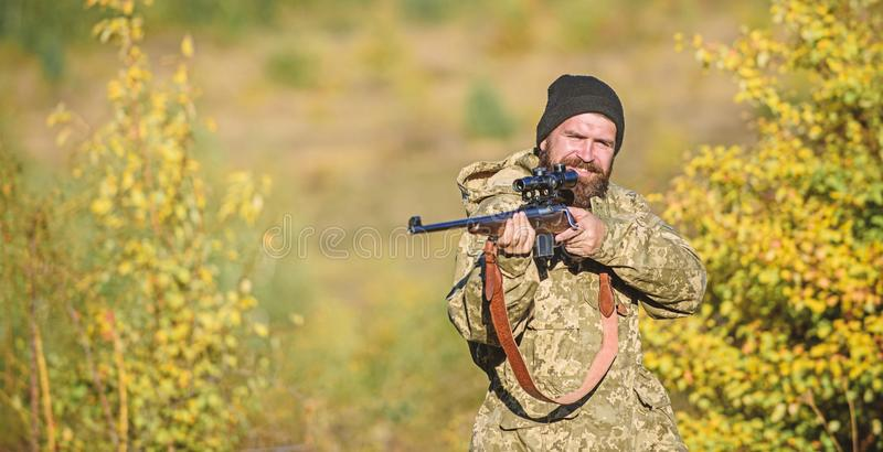 Focus and concentration of experienced hunter. Hunting masculine hobby concept. Man brutal gamekeeper nature background stock photo