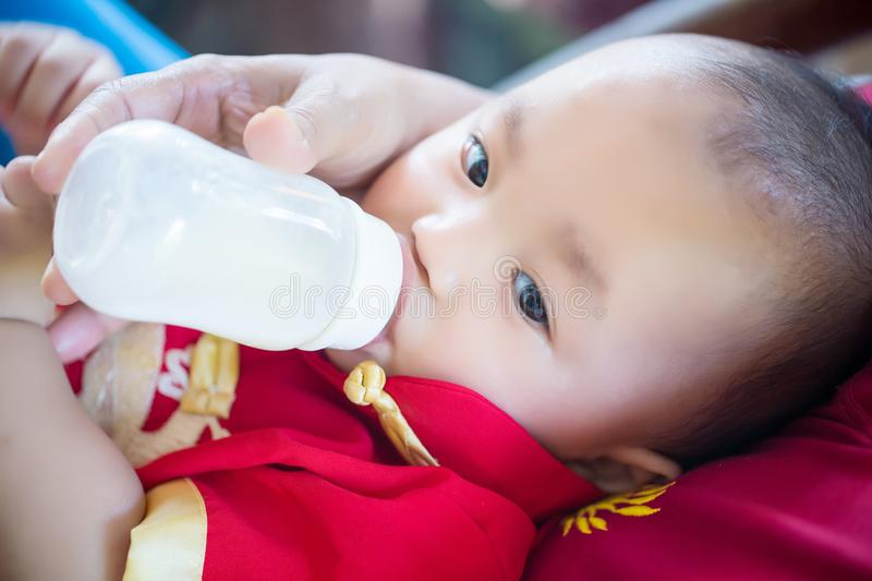 Focus cute baby boy wear red and gold chinese suit on chinese new year day. Fancy clothes for baby and child. pretty infant. Asian baby boy.image for royalty free stock photos