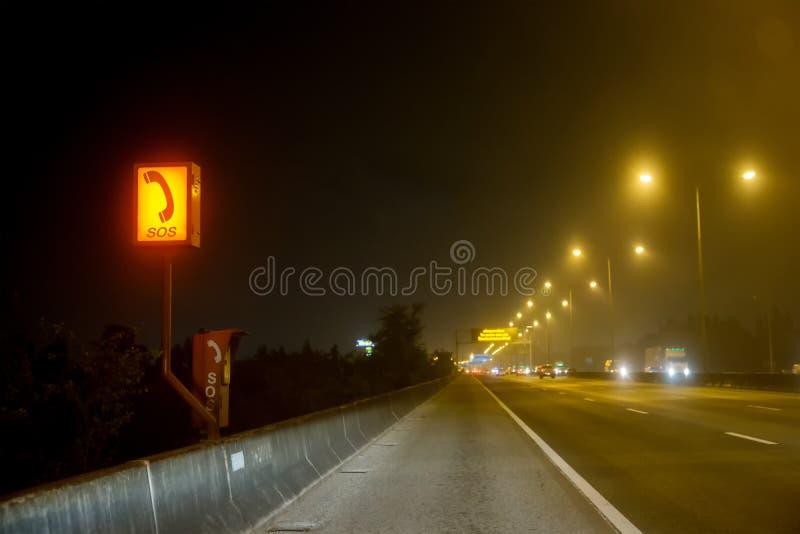 Focus emergency telephone on beside of motorway. sos phone on side way royalty free stock image