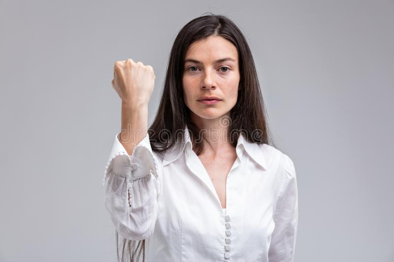 Focus on the FIST of a stern woman royalty free stock photo