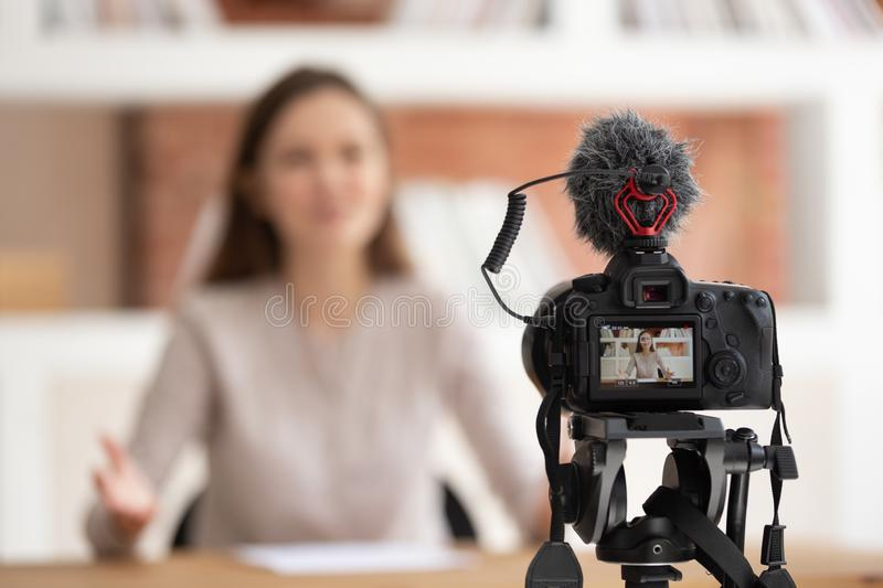 Woman seated in front of camera filming educational video royalty free stock photos