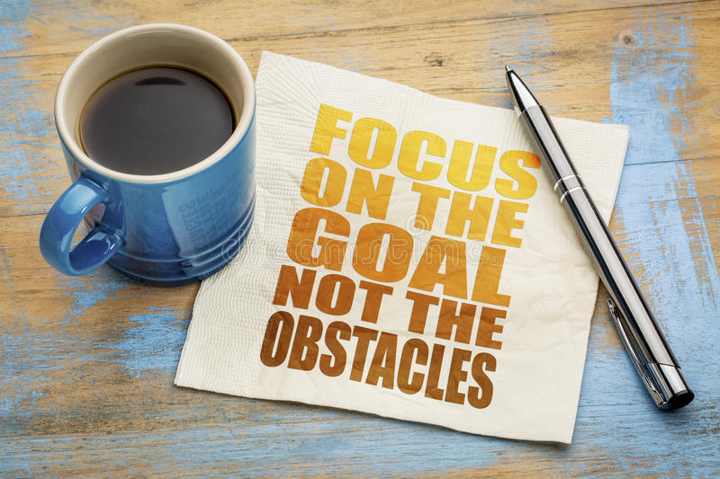 Focus on the goal, not obstacles - napkin concept stock photos