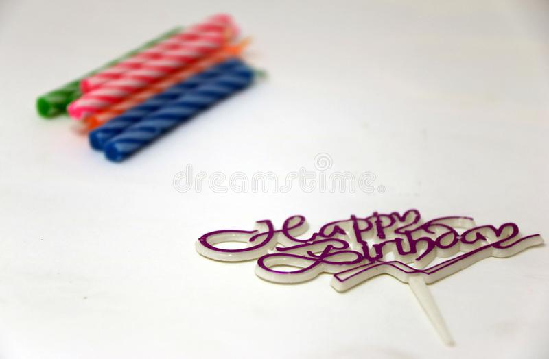 Focus happy birthday sign, pin for decorate cake and out focus colorful candle for birthday cakes. Use for bakery stock image
