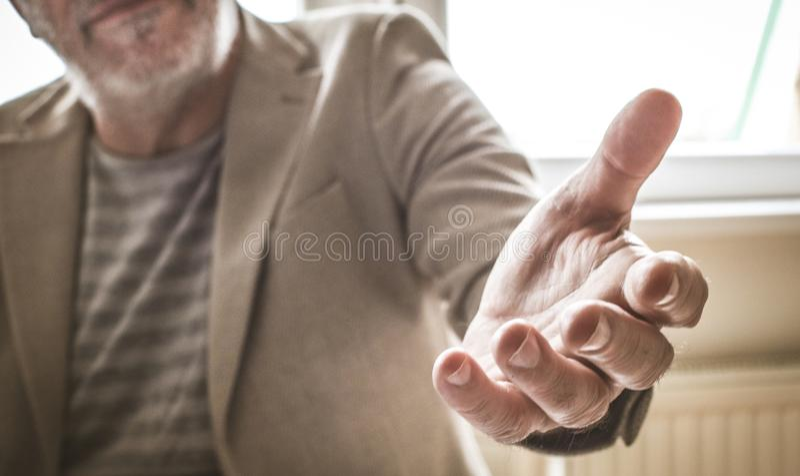 Focus of helping hand. Senior businessman. stock photos