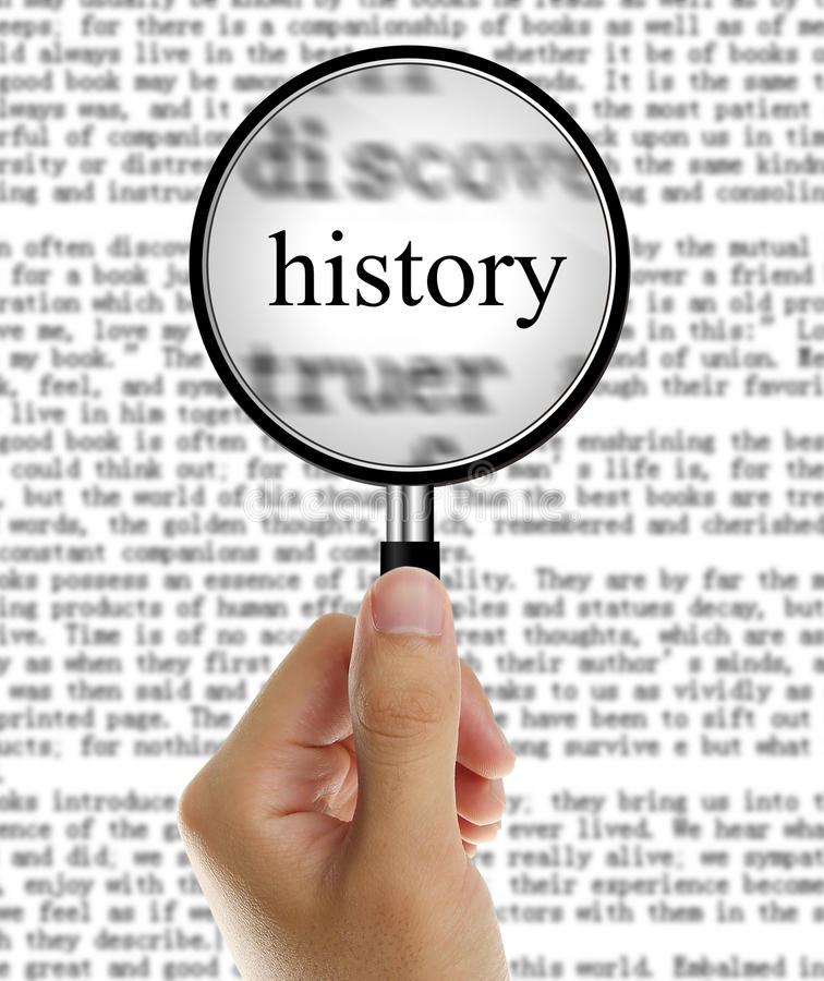 Focus On History. Magnifying Glass in Hand Focus On History royalty free stock photos