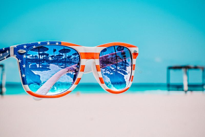 Focus Photography Of American Flag-accent Wayfarer-styled Sunglasses With Sea Background Free Public Domain Cc0 Image
