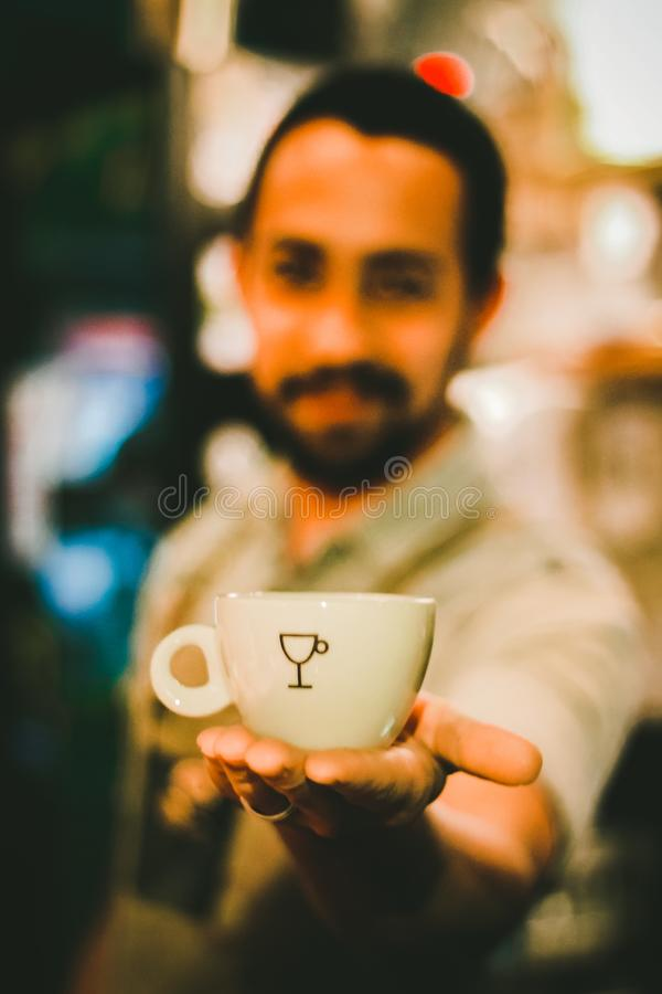 Focus Photography of Man Holding Ceramic Teacup royalty free stock photography