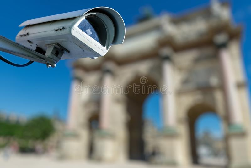 Security CCTV camera or surveillance system with ancient monument on blurry background. Focus on security CCTV camera or surveillance system with ancient stock image