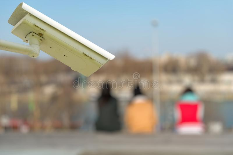 Security CCTV camera or surveillance system with tourists on blurry background. Focus on security CCTV camera or surveillance system with tourists on blurry royalty free stock photos