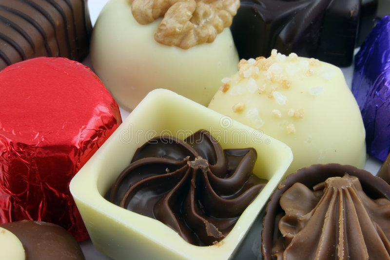 Focus on single chocolate. Close up of Luxury Chocolates royalty free stock photo