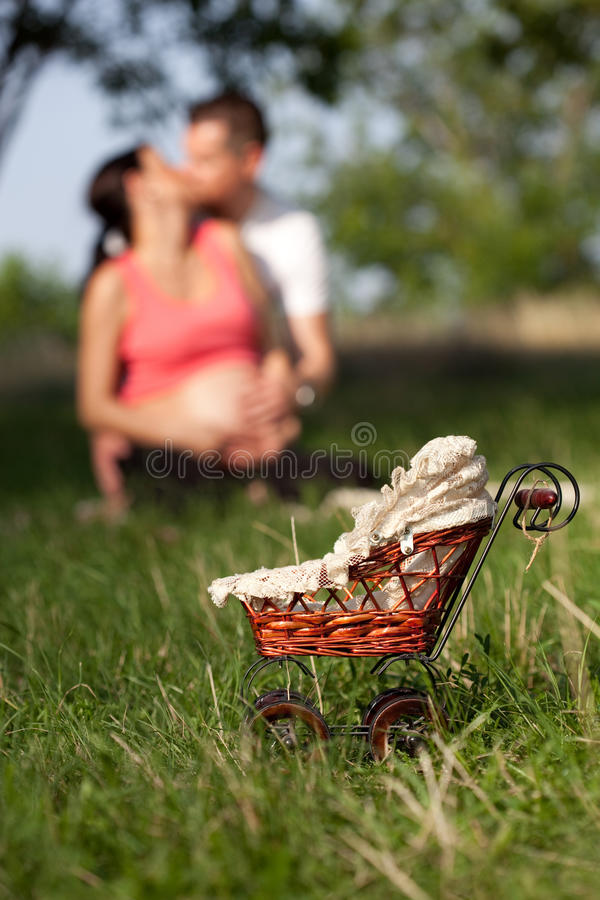 Download Focus Small Pram And Young Couple Stock Photo - Image: 33421288