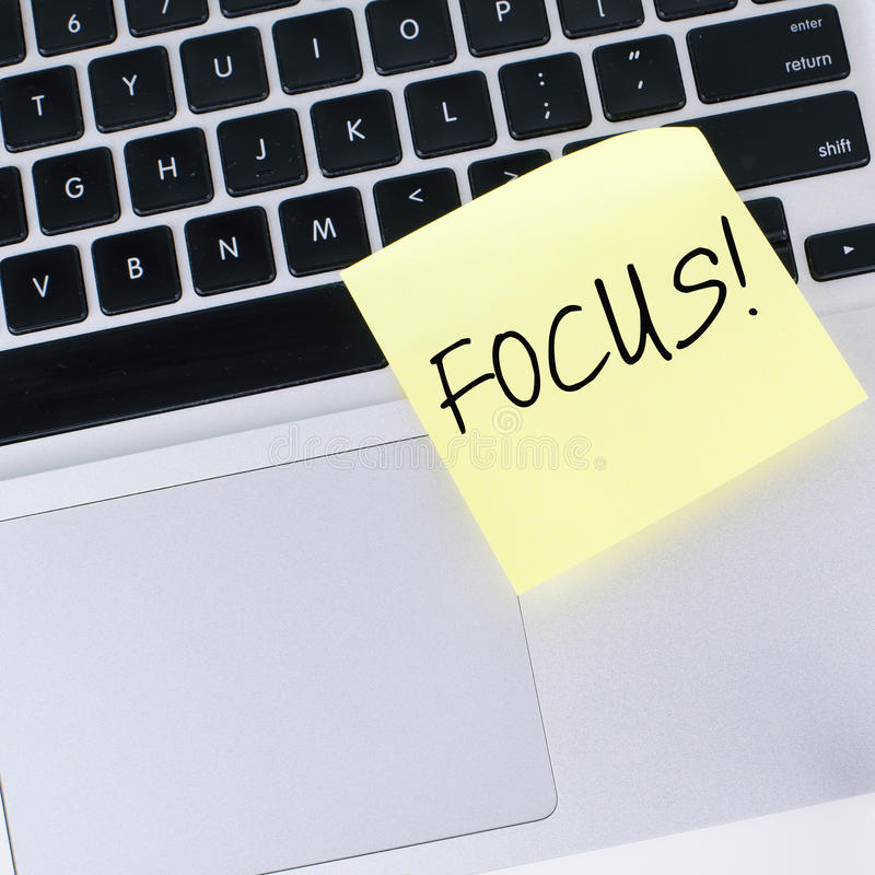 Focus. Sticky note on laptop royalty free stock photography