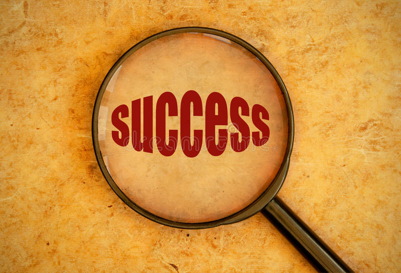 Focus on success. Magnifying glass focused on success stock photo