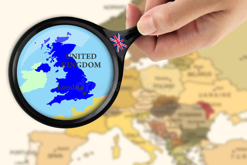 Focus in United Kingdom. Magnifying glass over a map of United Kingdom stock images