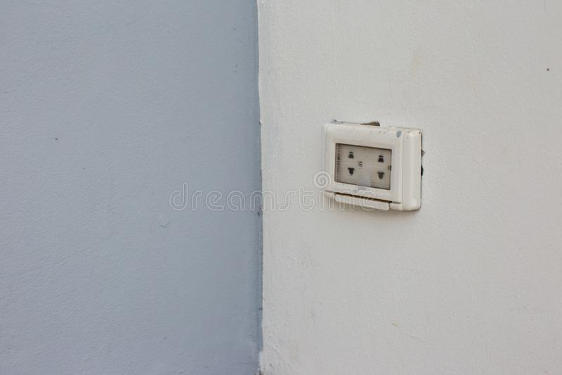 Focus white plug socket 2 chanels on the wood wall. electricity for house and city. Charging energy concept. image for background, copy space royalty free stock photo