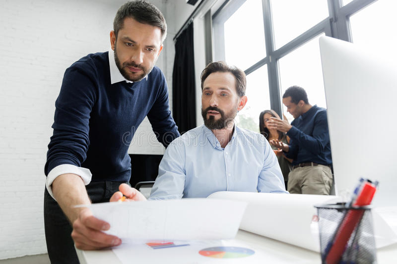 Focused business team working with documents stock image