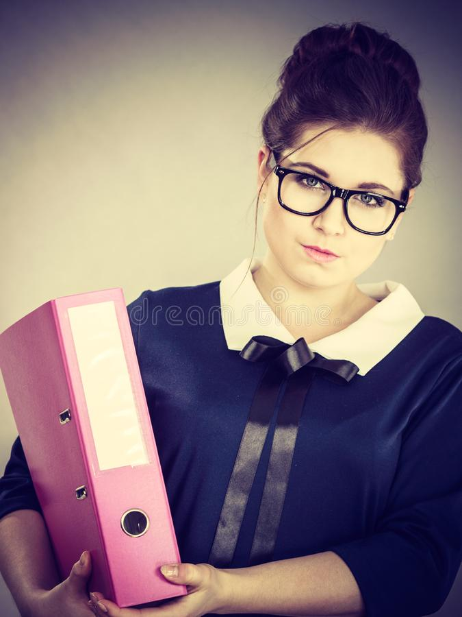 Focused business woman holding binder with documents royalty free stock image