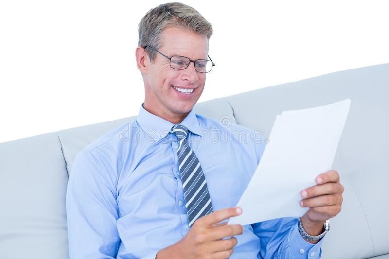 Focused businessman reading a document royalty free stock photography