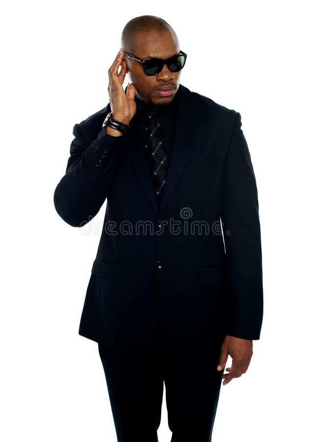 Focused Businessman Trying To Hear Something Royalty Free Stock Photography