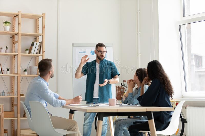 Focused diverse employees listening to leader lecturer in office. royalty free stock photos