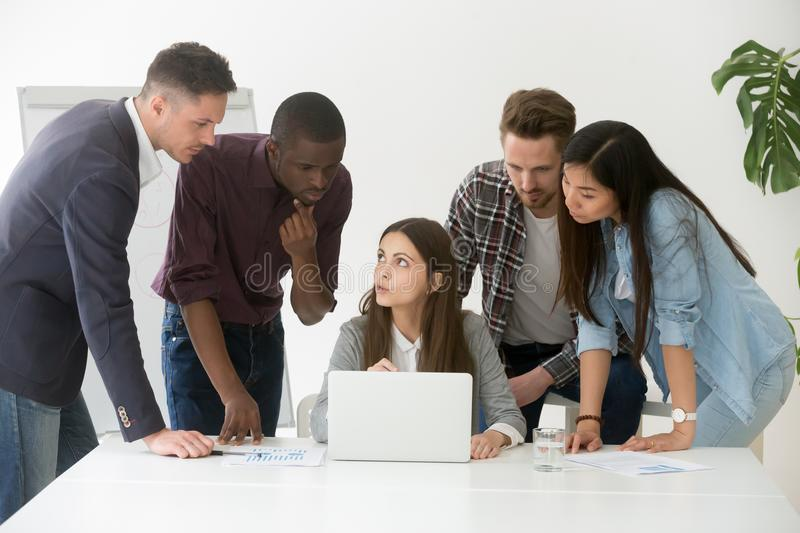 Focused diverse work team discussing online project royalty free stock image